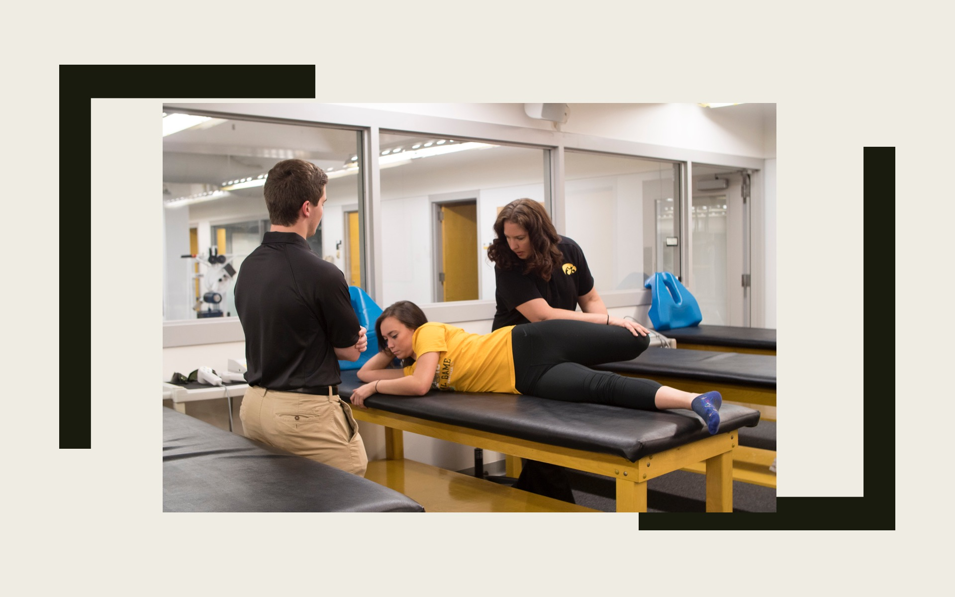 Faculty demonstrating hip flexor stretching to a watching student